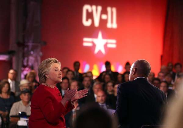 Democratic presidential nominee Hillary Clinton talks with