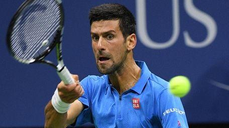 Novak Djokovic of Serbia returns to Jo-Wilfried Tsonga