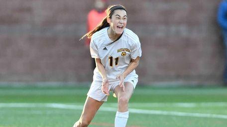 Massapequa's Hope Breslin (11) reacts to her goal
