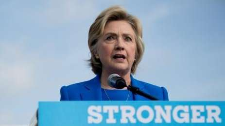 Democratic presidential candidate Hillary Clinton speaks to members