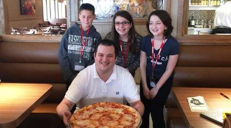 Kidsday reporters, from left, Johnathan Cantwell, Sydney Dunn