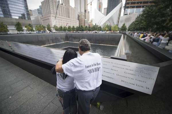 Friends and families gather at Ground Zero to