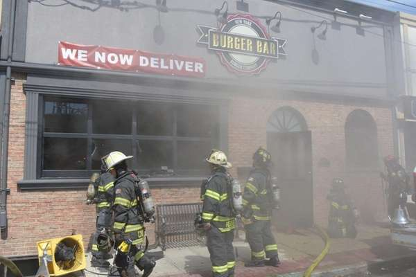 Firefighters respond to a building fire on Merrick
