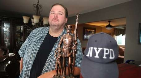Retired NYPD detective Kenny Anderson at his home