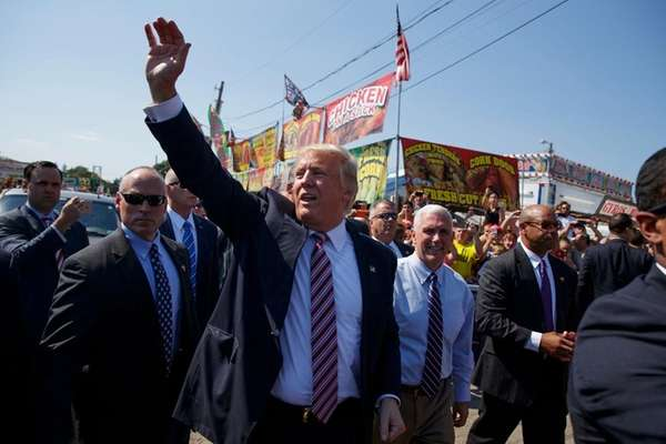 Republican presidential candidate Donald Trump waves as he