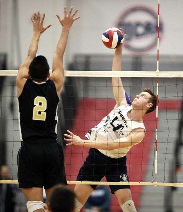Eastport's Tommy Ogeka, right, spikes the ball against