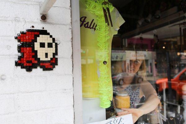 Islip store owner Lori Zegel stands beside