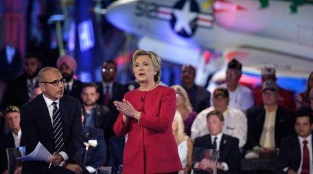 Matt Lauer, here with Hillary Clinton, took a