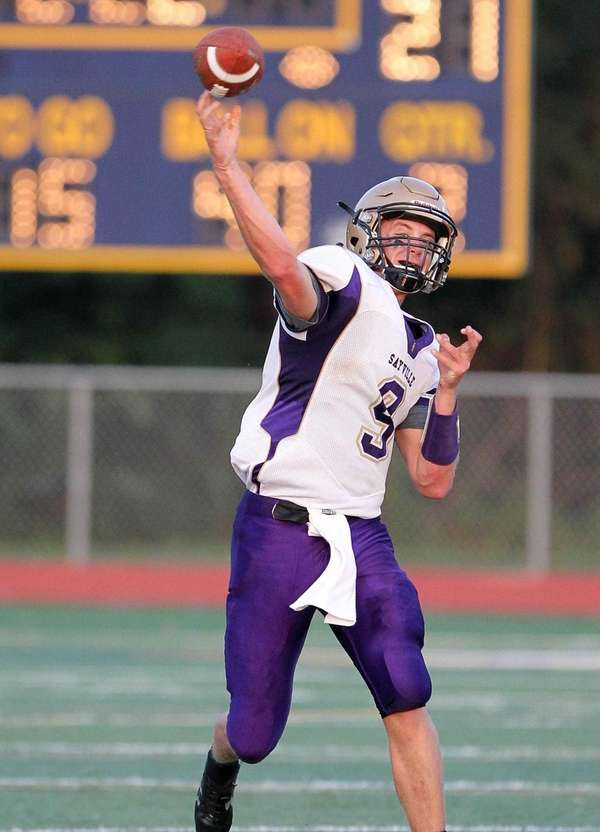 Sayville's Jack Coan (9) throws a pass in