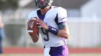 Sayville's Jack Coan (9) drops back and throws