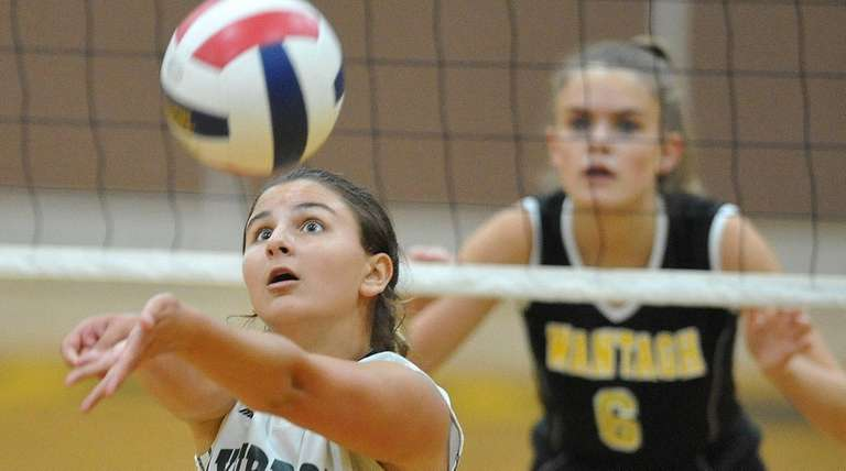 Crista Esposito of Lynbrook sets the ball during