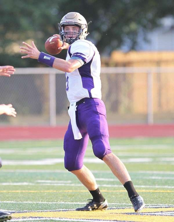 Sayville's Jack Coan drops back to pass in