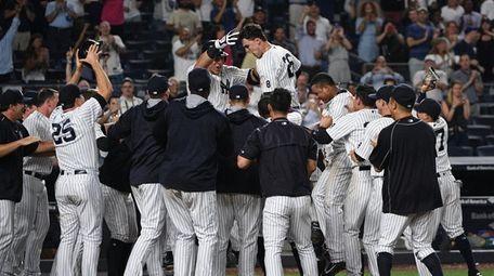 New York Yankees' Tyler Austin leaps on his