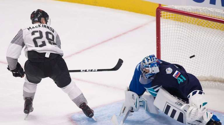 Team North America's Nathan MacKinnon scores on a