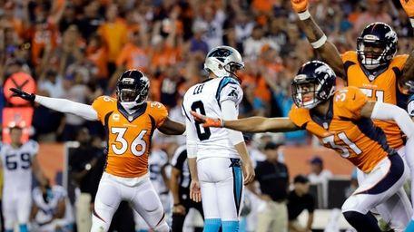 Denver Broncos cornerback Kayvon Webster (36) celebrates Carolina