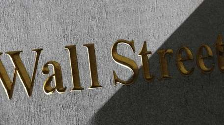 A Wall Street sign is seen on the