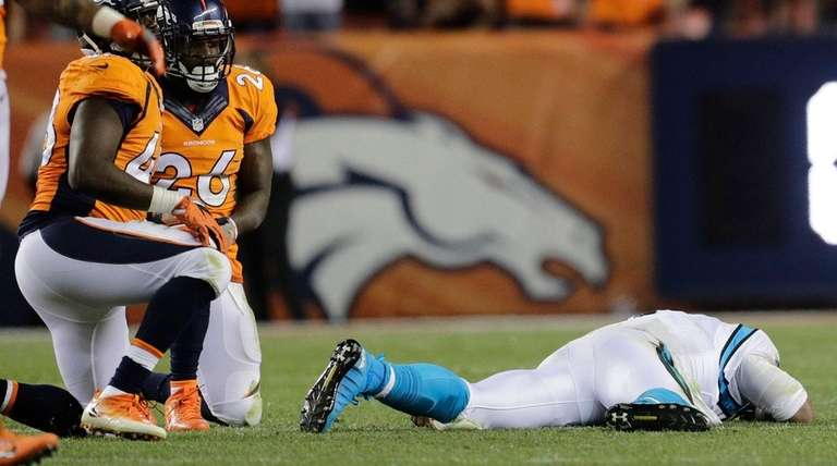 Carolina Panthers quarterback Cam Newton (1) lies on