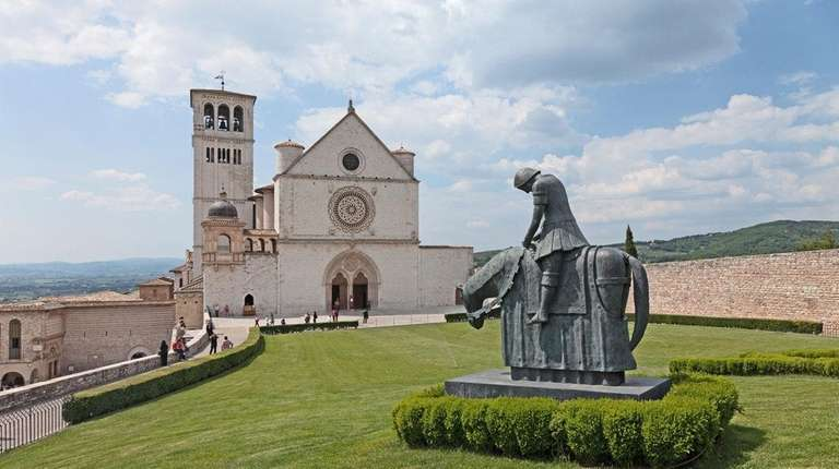 The Basilica of St. Francis rises from a