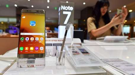 A woman tests a Samsung Galaxy Note7 smartphone