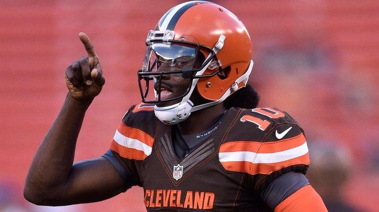 Cleveland Browns quarterback Robert Griffin III runs onto