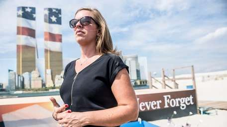 Kerri Kiefer-Viverito stands in front of the 9/11