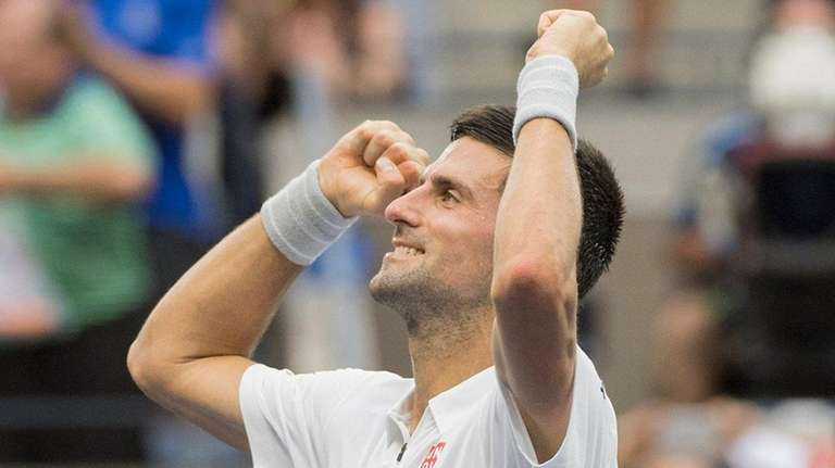 Novak Djokovic reacts after defeating Gael Monfils in