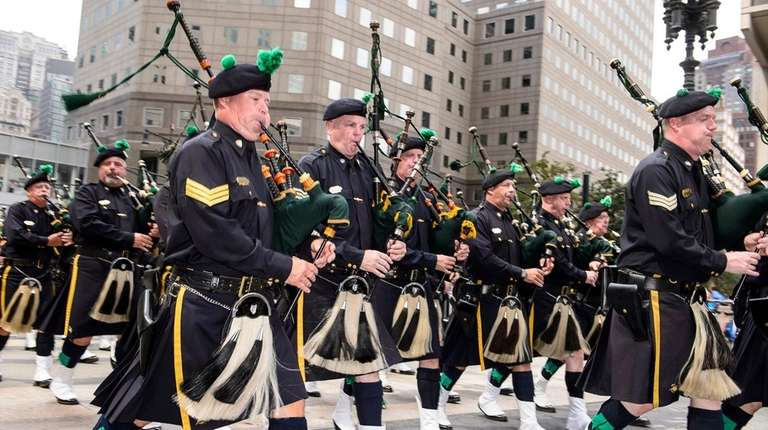 Pipers march in the parade and ceremony to