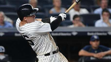 New York Yankees first baseman Tyler Austin hits
