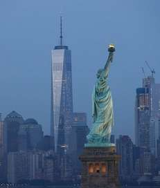 The Statue of Liberty stands in the foreground