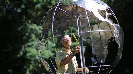 Sculptor David Haussler works on a 9-11 sculpture