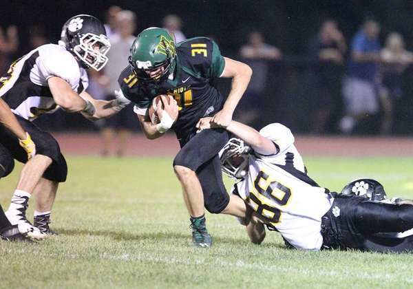 Ward Melville's Nick Messina (31) gains some yards