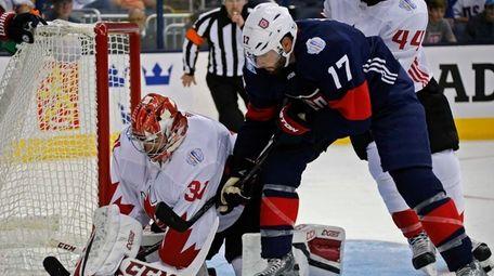 Team Canada's Carey Price (31) makes a save