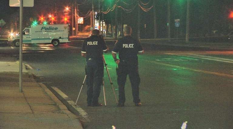Suffolk County police investigate an accident scene at