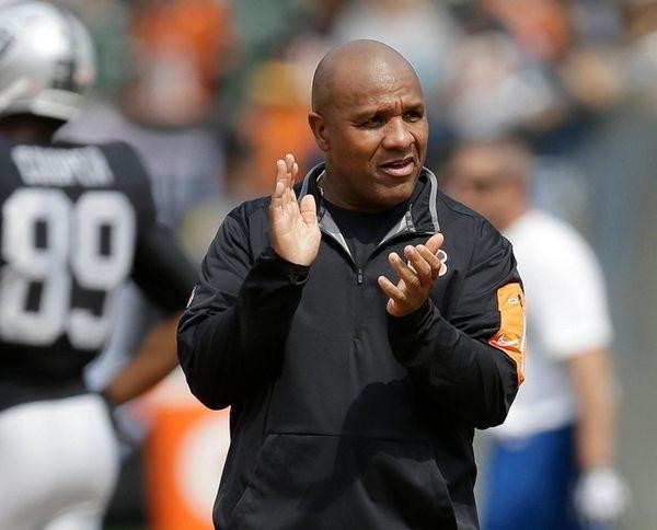 Former Cincinnati Bengals offensive coordinator Hue Jackson watches