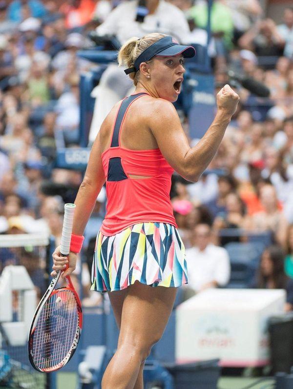 Angelique Kerber pumps her fist after winning the