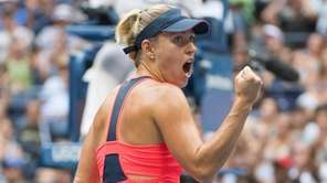 Angelique Kerber pumps her fist after winning the