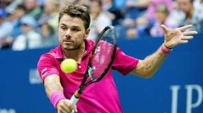 Stan Wawrinka hits a backhand against Kei Nishikori
