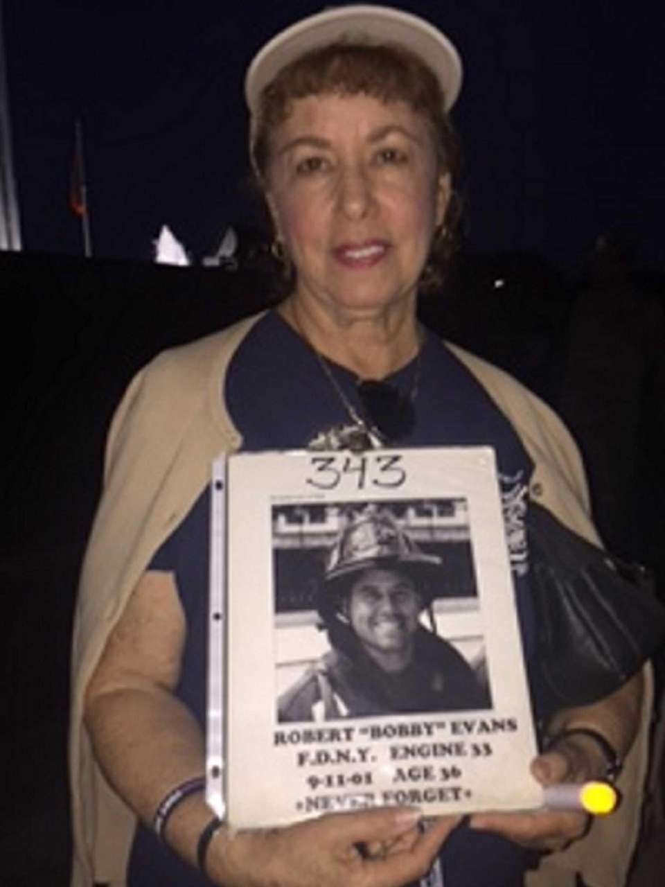 Christina Evans holds a photo of her son