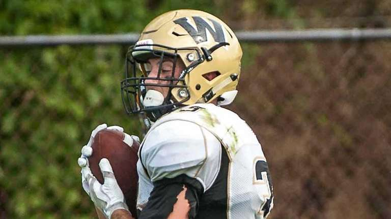 Wantagh's Jimmy Joyce runs with the ball during