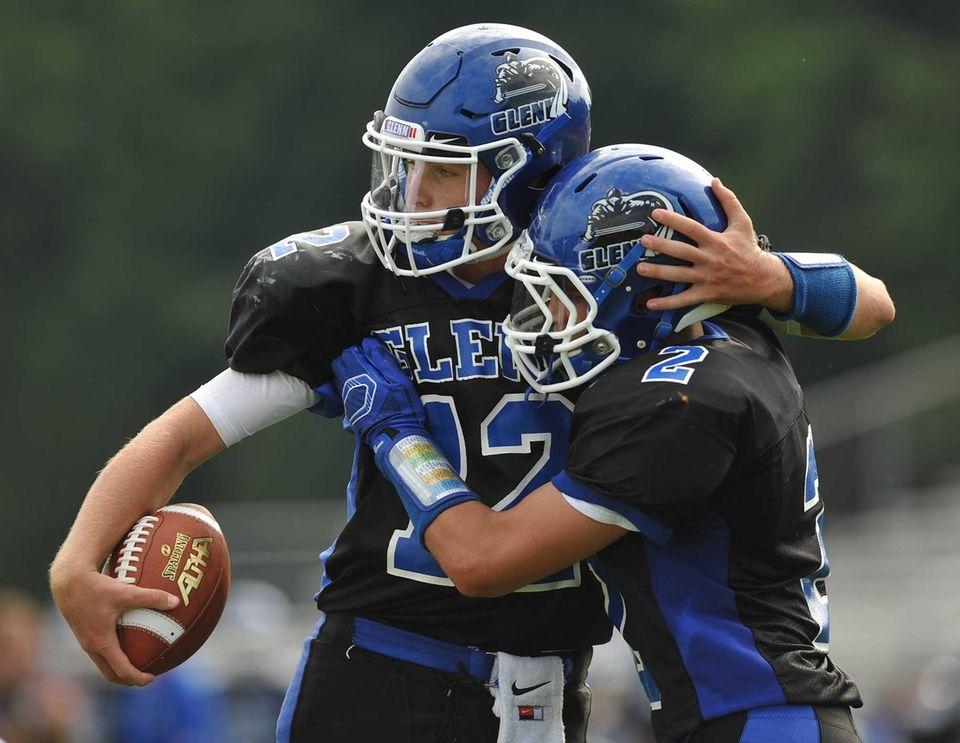 Glenn quarterback Kyle Tiernan #12, left, gets congratulated