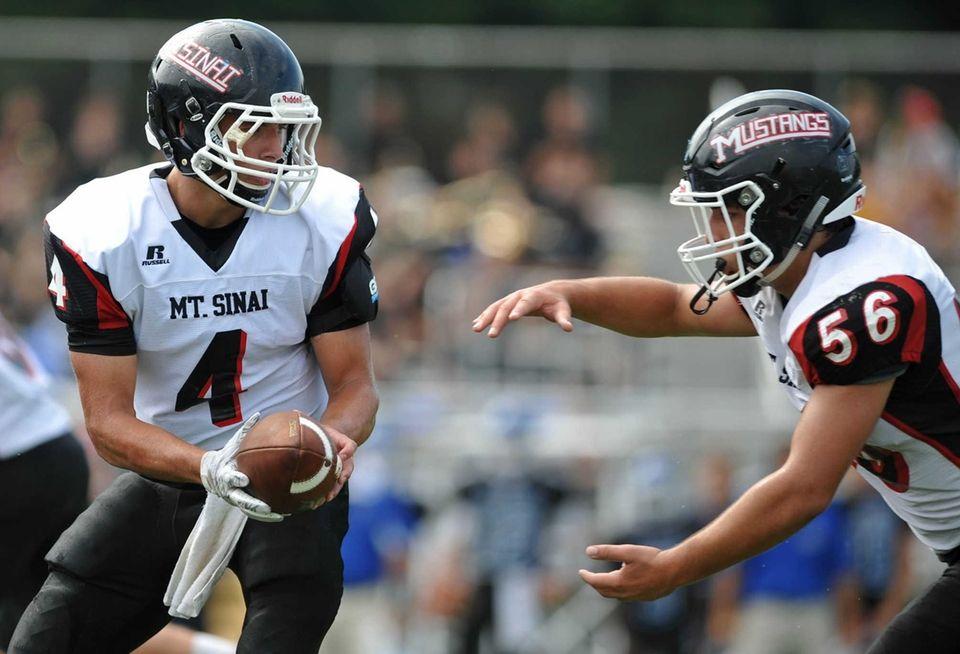 Mount Sinai quarterback Jason Shlonsky #4, left, hands