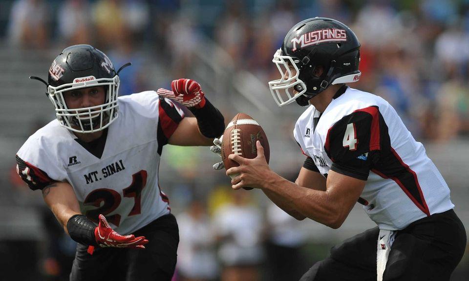 Mount Sinai quarterback Jason Shlonsky #4, right, fakes