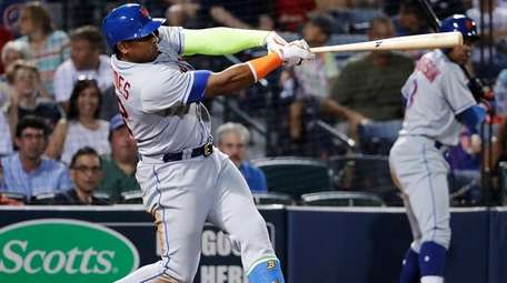 New York Mets' Yoenis Cespedes hits a home