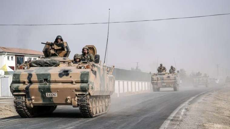 Turkish army tanks and armored personnel carriers move