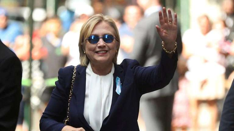 Democratic presidential candidate Hillary Clinton waves after leaving