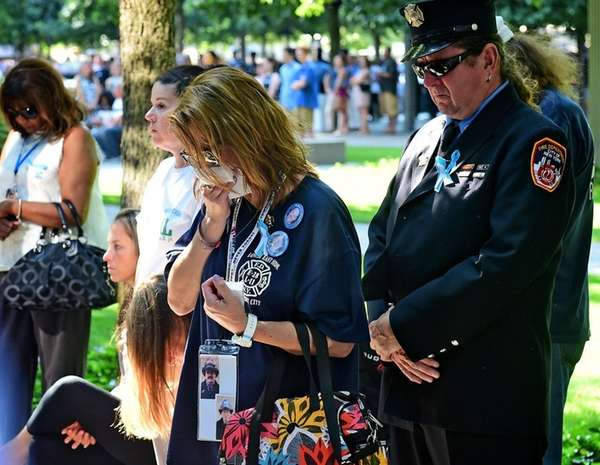 Kristen Alverson cries during a moment of silence