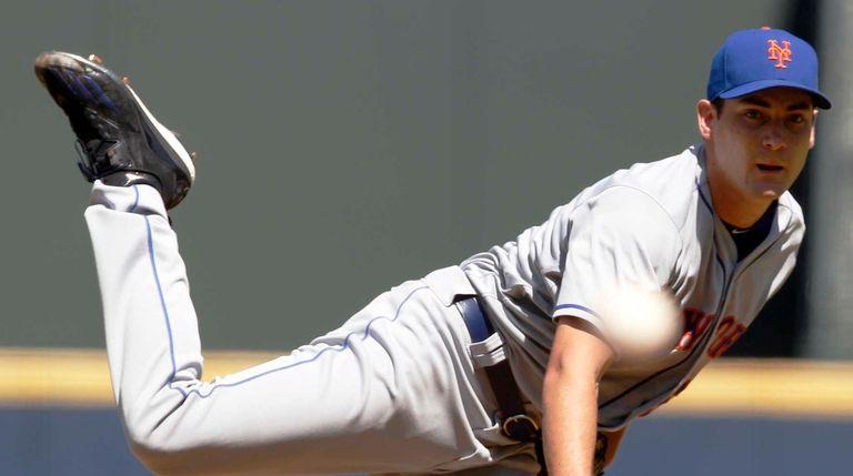 New York Mets starting pitcher Seth Lugo throws