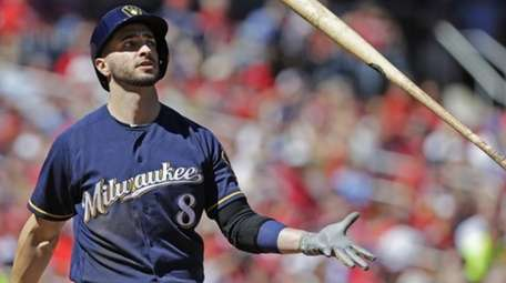 Milwaukee Brewers' Ryan Braun (8) tosses the bat