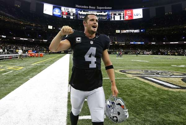 Derek Carr #4 of the Oakland Raiders celebrates