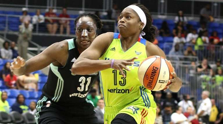 Dallas Wings forward Karima Christmas (13) drives to